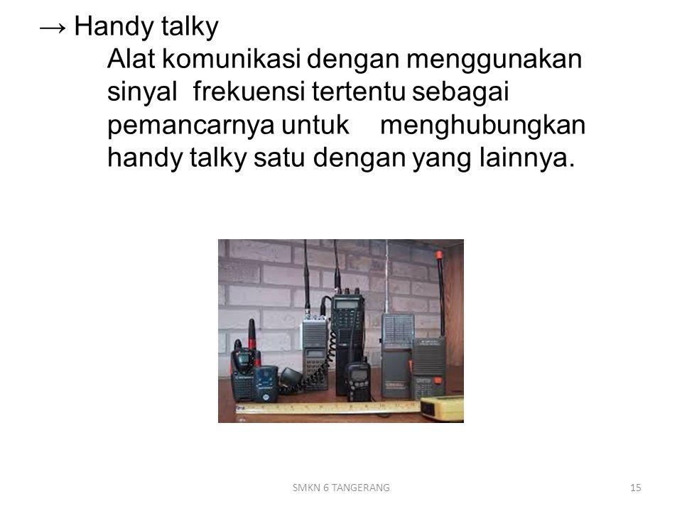 → Handy talky. Alat komunikasi dengan menggunakan