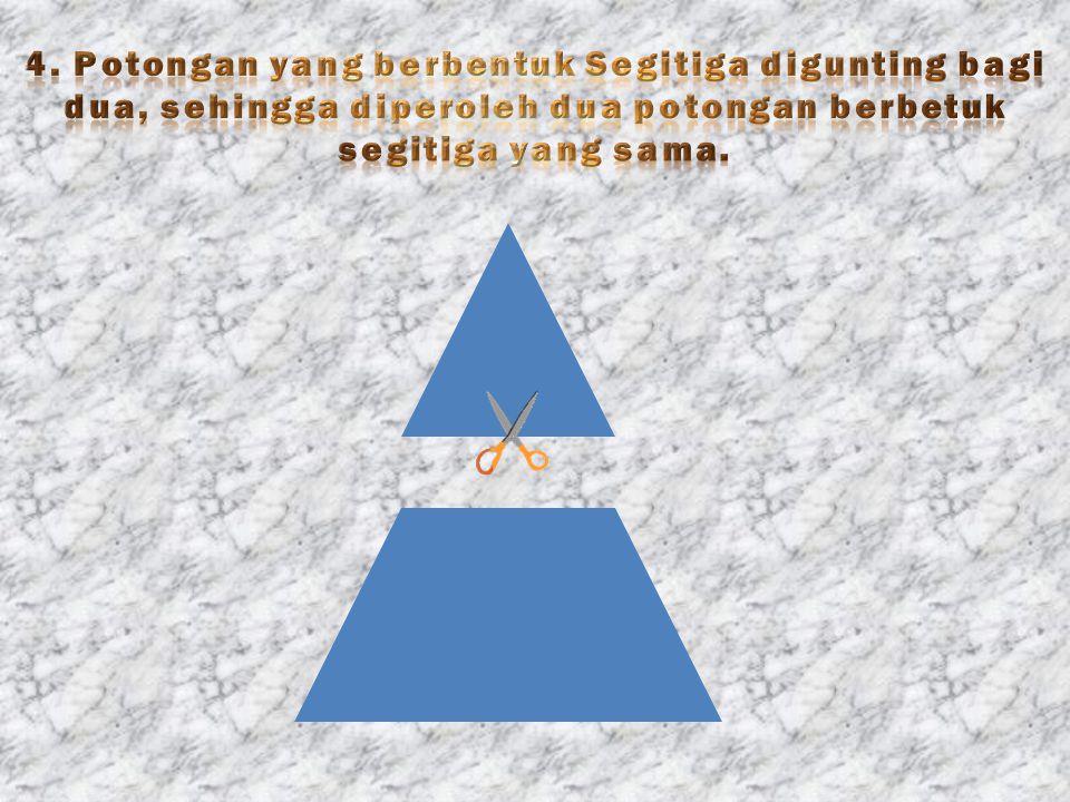 4. Potongan yang berbentuk Segitiga digunting bagi dua, sehingga diperoleh dua potongan berbetuk segitiga yang sama.
