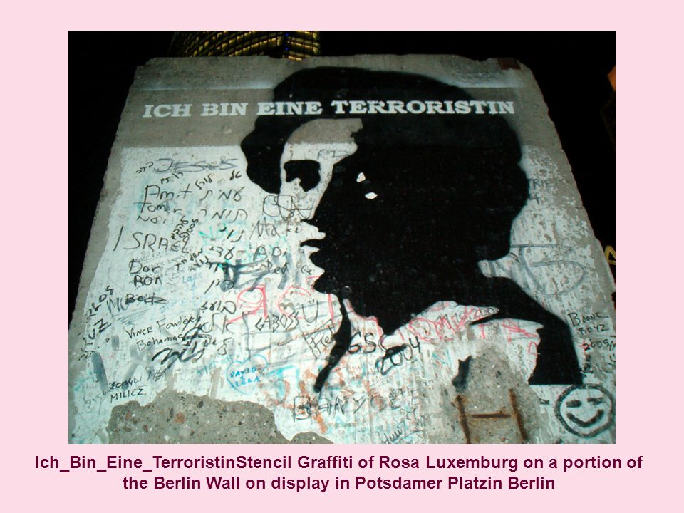 Ich_Bin_Eine_TerroristinStencil Graffiti of Rosa Luxemburg on a portion of the Berlin Wall on display in Potsdamer Platzin Berlin