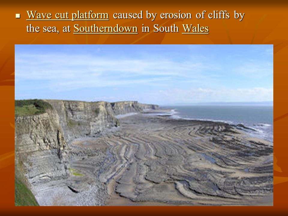 Wave cut platform caused by erosion of cliffs by the sea, at Southerndown in South Wales