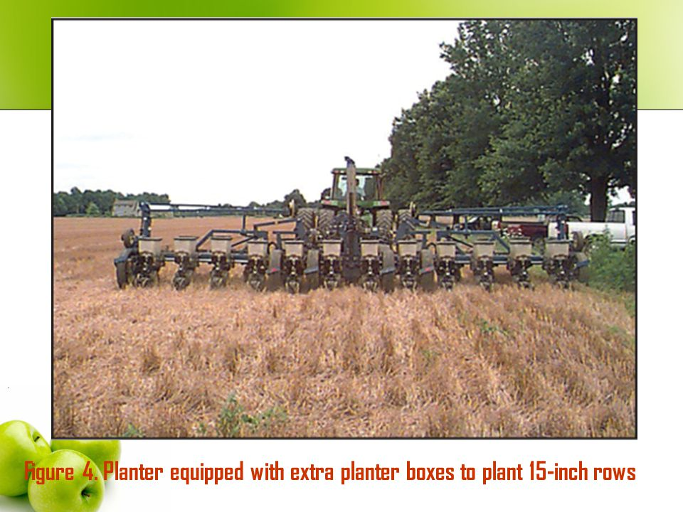. Figure 4. Planter equipped with extra planter boxes to plant 15-inch rows