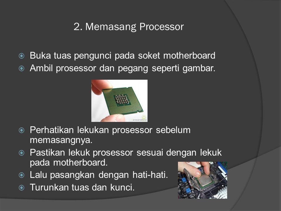 2. Memasang Processor Buka tuas pengunci pada soket motherboard