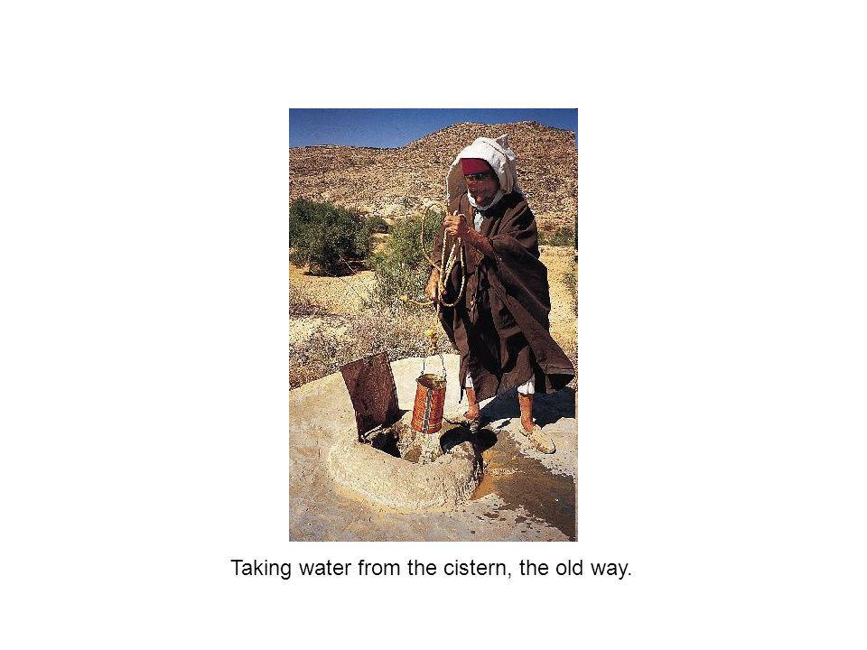 Taking water from the cistern, the old way.