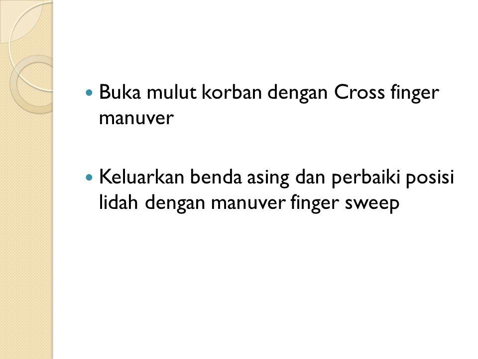 Buka mulut korban dengan Cross finger manuver