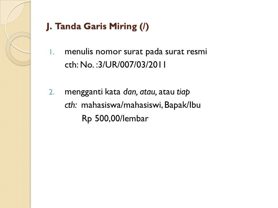 J. Tanda Garis Miring (/)
