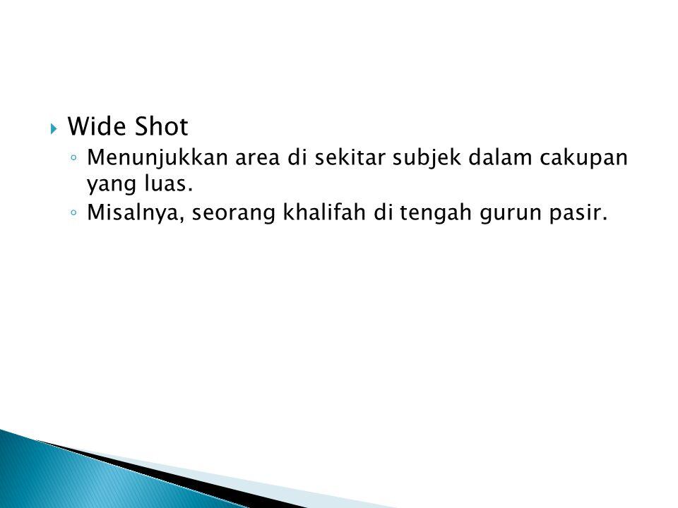 Wide Shot Menunjukkan area di sekitar subjek dalam cakupan yang luas.