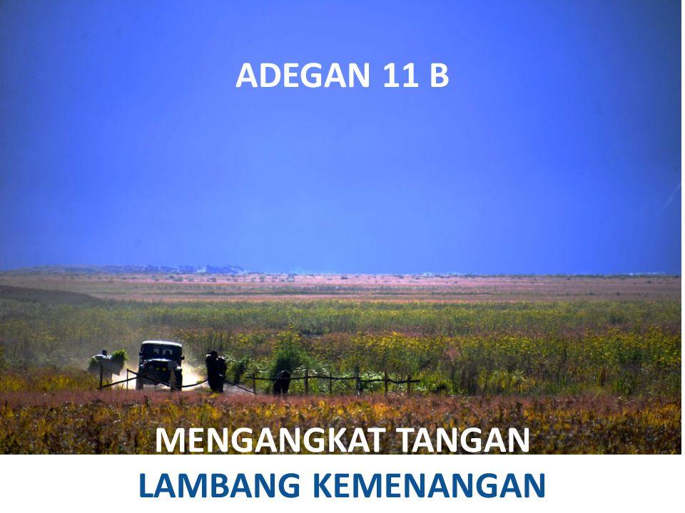 ADEGAN 11 B MENGANGKAT TANGAN LAMBANG KEMENANGAN